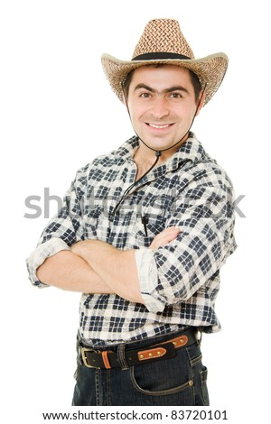 Cowboy folded his arms across his chest. - stock photo
