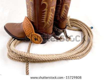 Cowboy gear - western riding equipment, spurs and rope - stock photo