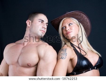 Cowboy girl and boy. Art shot of a pretty models .