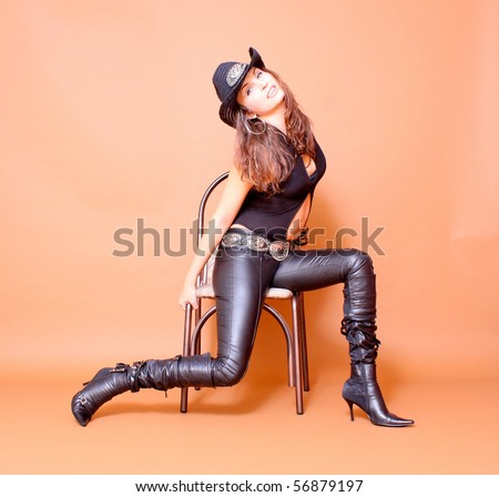Cowboy girl wearing leather pants - stock photo