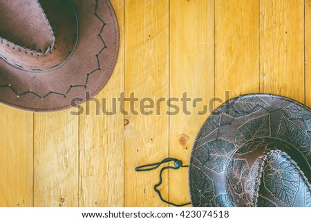 Cowboy hat on wooden background - stock photo