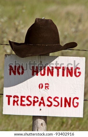 Cowboy hat over posted sign in Saskatchewan - stock photo