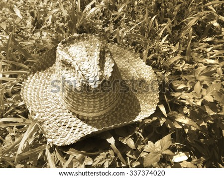 Cowboy hat with sepia tone. - stock photo