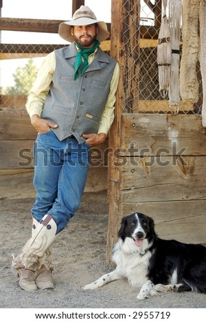 Cowboy passing the time with his trusty dog - stock photo