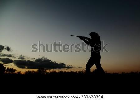 cowboy shotgun in texas ranch - stock photo