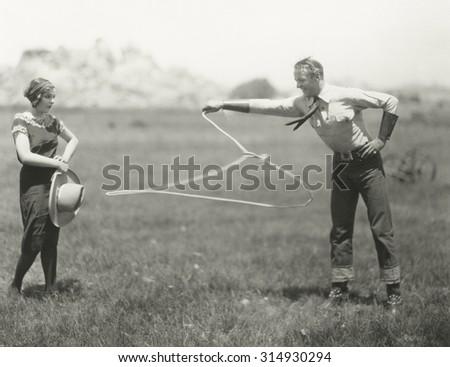 Cowboy showing off his roping skills - stock photo