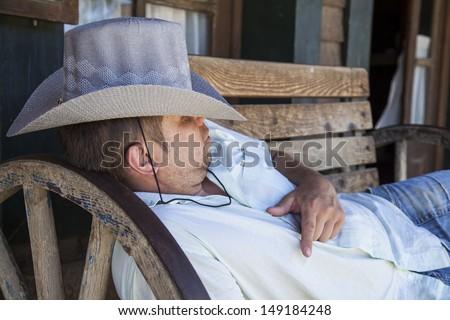 Cowboy sleeping  - stock photo