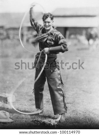 Cowboy spinning lasso - stock photo