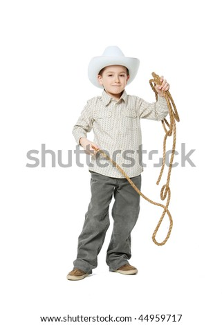 Cowboy with a lasso in the studio on a white background. - stock photo