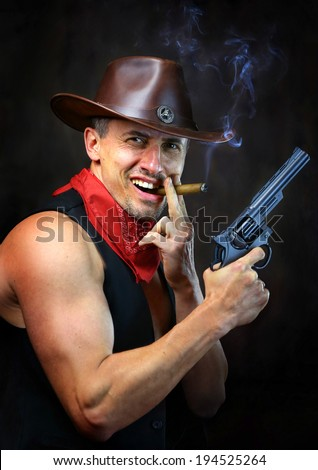 Cowboy with gun and smoking cigar - stock photo