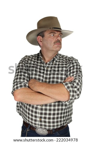 Cowboy with his hands crossed on a white background