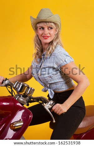 Cowboy woman sitting on a moped - stock photo