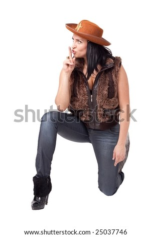 cowgirl in jeans, boots and cowboy hat sitting against isolated white background