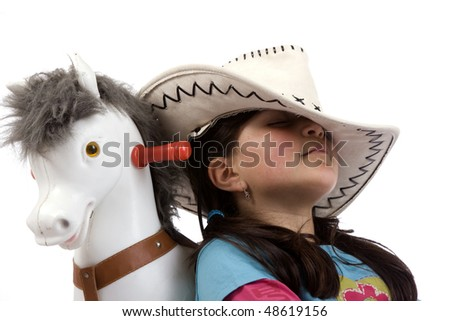 cowgirl sleep with toy horse - stock photo