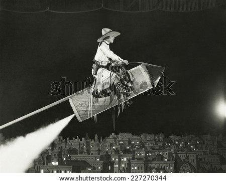 Cowgirl takes off on a rocket - stock photo