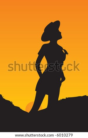 cowgirl with her hat and pony-tail standing behind the sunset