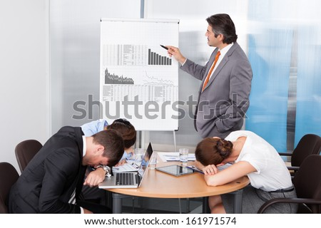Coworkers Getting Bored At Presentation In The Office - stock photo