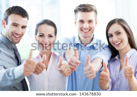 Coworkers showing thumbs up