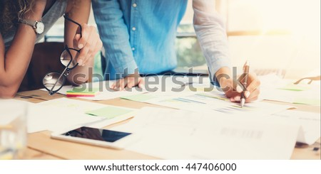 Coworkers Work Process Modern Office Loft.Account Managers Team Produce New Idea Project.Young Business Crew Working Startup.Smartphone Wood Table.Analyze Market Reports.Blurred,Film Effect.Wide - stock photo