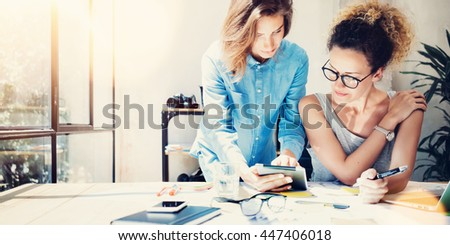 Coworkers Work Process Modern Office Loft.Young Professionals Making Great Decisions New Creative Idea.Business Team Working Startup.Laptop Wood Table.Analyze Sales Reports.Blurred.Film,Flare Effect - stock photo