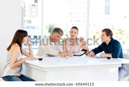 Coworkers working in their office at work - stock photo
