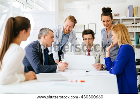 Coworkers working on project together in office