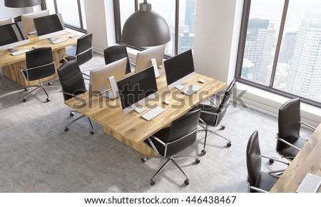 Coworking office interior with multiple blank computer screens on workplaces and windows with New York city view. View from above. 3D Rendering