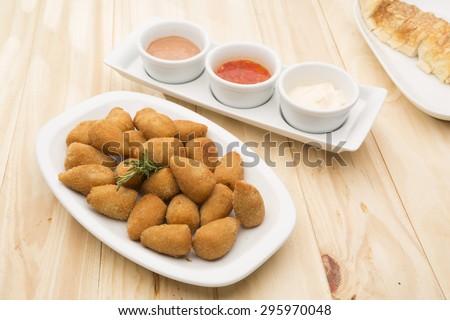 Coxinha de Galinha - Brazilian deep fried chicken snack, popular at local parties. - stock photo