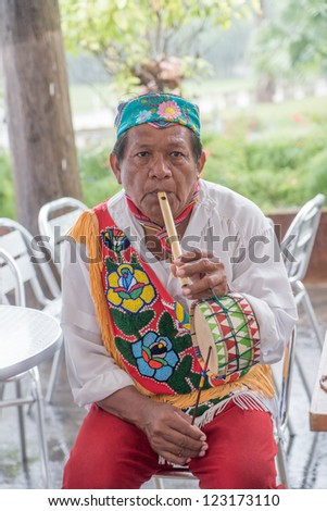 COZUMEL - DEC 12: Mayan dancer plays a flute and drum  in Cozumel on December 12, 2012. Dance is still a central component of social and political life for the Mayan and their  Maya-Catholic rituals.
