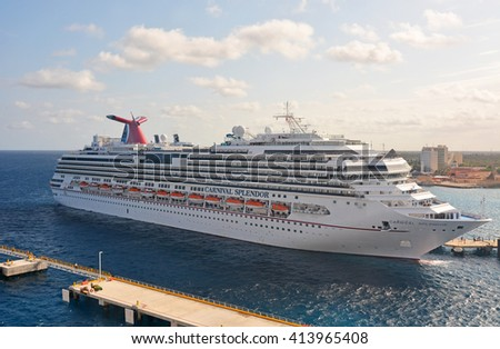 COZUMEL, MEXICO - APRIL 10, 2016: Big docked cruise liners - stock photo