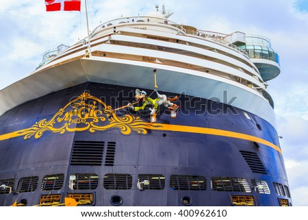 COZUMEL, MEXICO - JAN 26 2016: NCL Dawn & Disney Magic at Cozumel port. Over 3,500 passengers visited that beautiful tropical island. The economy of Cozumel is based on tourism - stock photo
