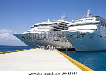COZUMEL, MEXICO - MARCH 23 : Carnival Cruise Line ships dock at the harbor March 23, 2009 in Cozumel, Mexico. - stock photo