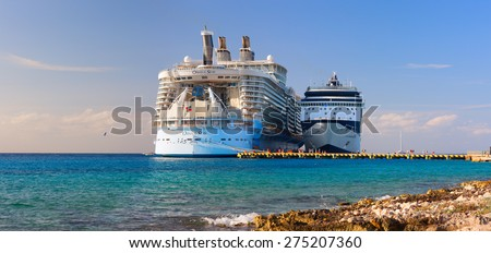 "COZUMEL, MEXICO - MARCH 7, 2013: The biggest ship in the world ""Oasis of the Seas"" was docked. Over 5,500 passengers went out to visit tropical island. - stock photo"