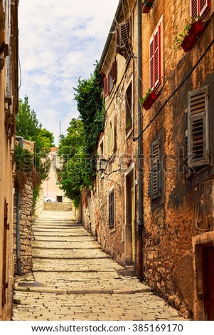 Cozy and narrow streets in Pula's medieval old town, Croatia - stock photo