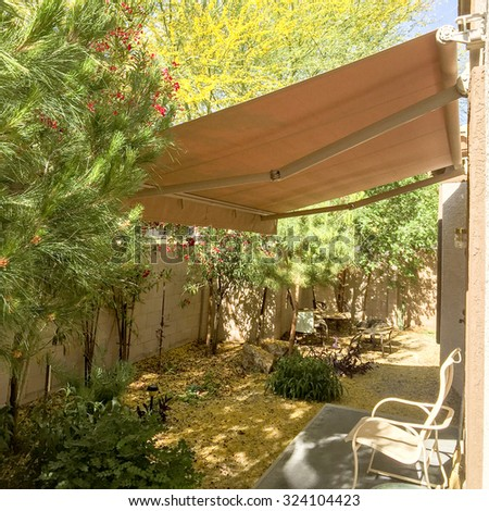 Cozy and shady automatic retractable awning for extra cooling, Arizona backyard