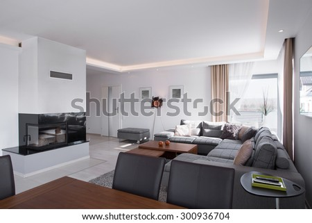 Cozy and sunny living room with a fireplace  - stock photo