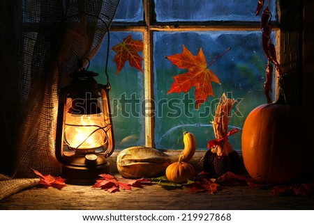 cozy atmosphere with lantern at home - stock photo