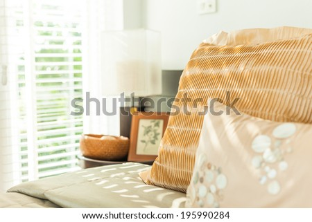 cozy bedroom with morning light - stock photo
