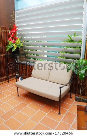 cozy chair in home garden - stock photo
