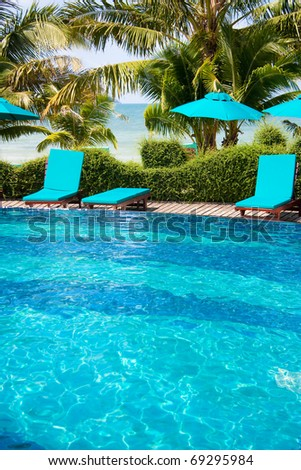 Cozy chairs near luxury pool - stock photo