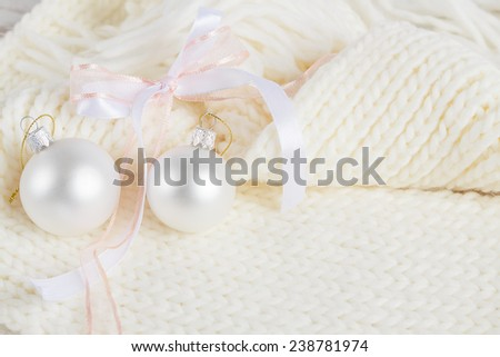 Cozy Christmas composition on white knitted background. Copy Space - stock photo