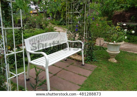 Cozy Corner in the Backyard with a white Iron Bench