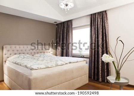 Cozy family bedroom interior - double bed and window - stock photo