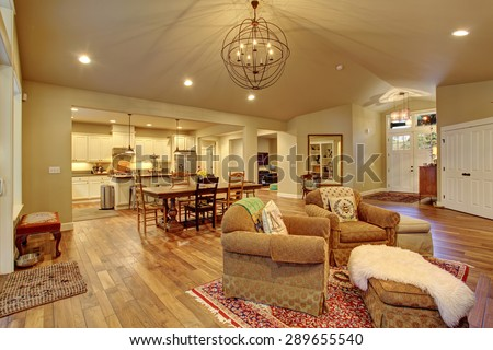 Cozy family room, dinning room, and kitchen with decor. - stock photo