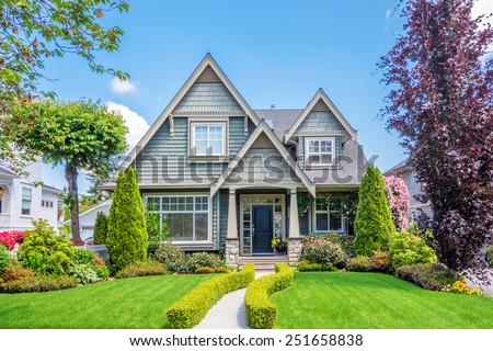 Beautiful Landscaping luxury blue house beautiful landscaping on stock photo 305311778