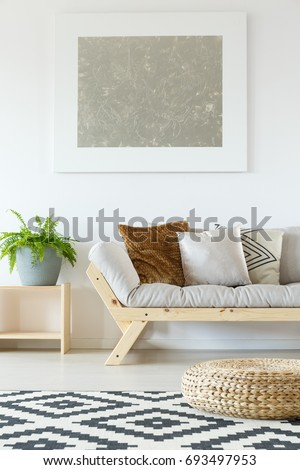 Cozy Interior In White Natural Studio Apartment With Beige Couch, Wood,  Plants, Rattan