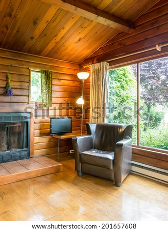Cozy interior of a rustic log cabin. - stock photo