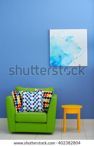 Cozy interior with armchair indoors - stock photo