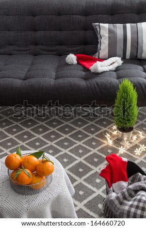 Cozy interior with Christmas decorations and little green tree. - stock photo