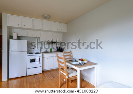 Cozy Kitchen With A Small Dinner Table. Interior Design.